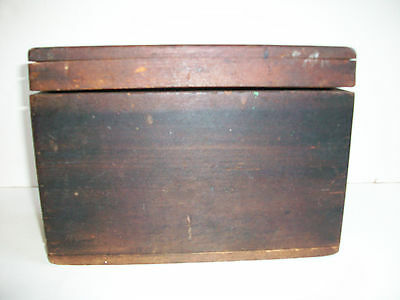 Primitive wood box with hinged lid