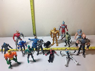 Action figure set of over a dozen figures. Spiderman, fantastic 4, and others