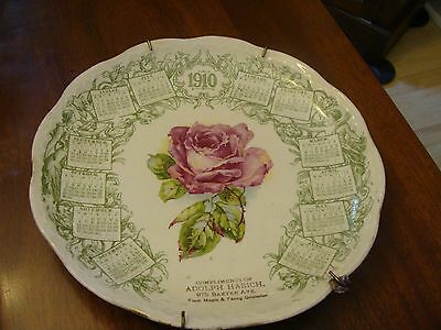 Vintage advertising plate, 1910 calendar with painted rose in the middle