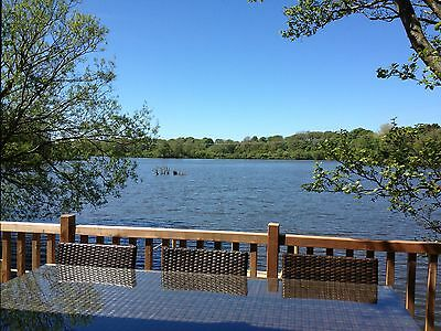 Self Catering holiday lodge/wooden cabin lakeside with own FREE boat bikes lakes