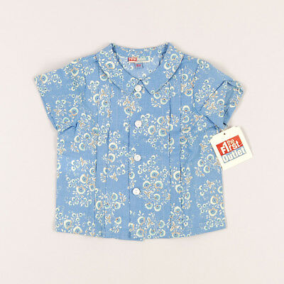 Camisa flores con 3 botones de marca The First outlet en color Azul 6 Meses