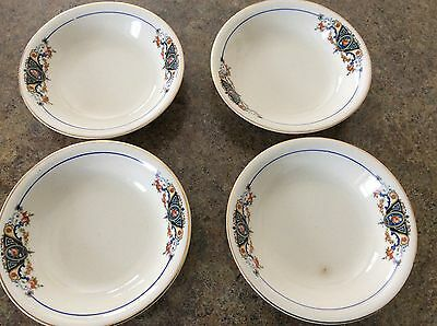 The Edwin M Knowles Ivory 11-2-27 set of 4 small bowls