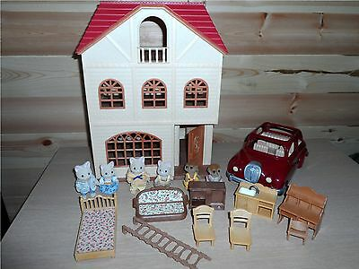 Sylvanian Families Cedar Terrace Bundle with red Woody Car and figures