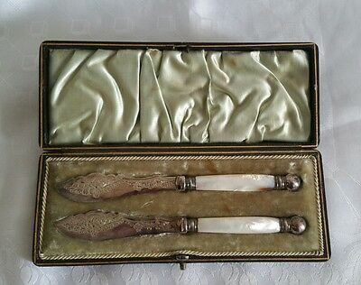 Beautiful pair of antique boxed butter knives with mother of pearl handles