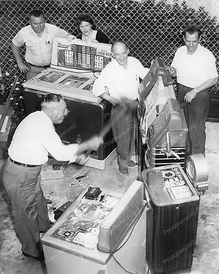 """Confiscated Slot Machines Being Sledgehammered 8"""" - 10"""" B&W Photo Reprint"""