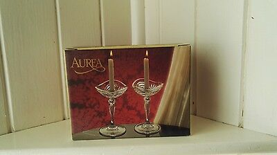 A pair of Royal Crystal Rock glass candle holders with candles