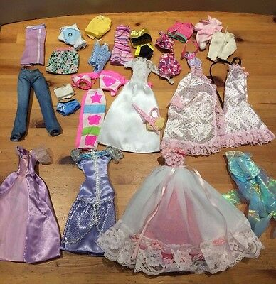 bundle of mixed barbie doll clothes older/modern/others