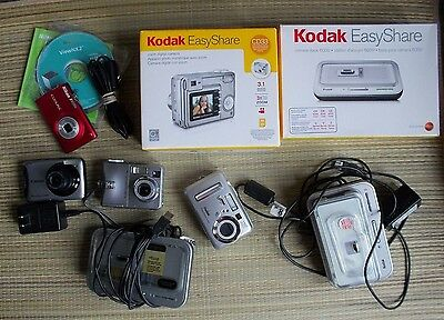 Assorted; parts or repair 4 cameras & 2 docks photography Kodak Canon Nikon lot