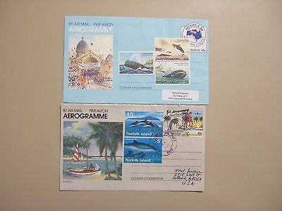 Two Norfolk Is aerogrammes with Dolphin and Whales stamps