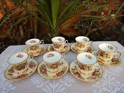 Elizabethan Staffordshire Bone China,hand decorated Fruit pattern cups& saucers