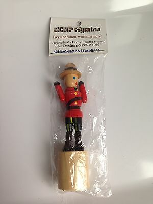 RARE!Wooden CANADIAN MOUNTIE RCMP Figurine, Press Button Puppet, Collapsing