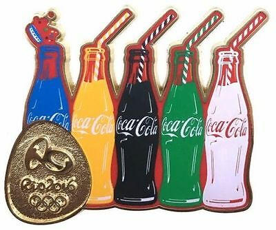 Rio 2016 Olympics Coca Cola 5 Bottles with Gold Rio Logo dated PIN Badge
