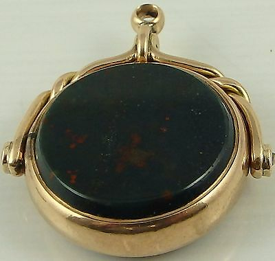 Antique 9ct gold swivel watch fob set with 2 hard stones