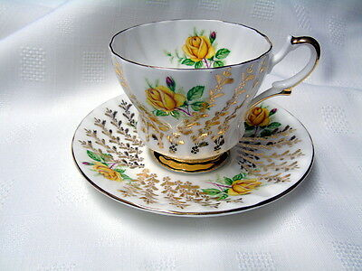 Queen Anne Bone China Tea Cup and Saucer. Yellow rose with gold filigree