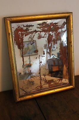 A Vintage Antique French Foxed Distressed Gesso Over Pine Mirror