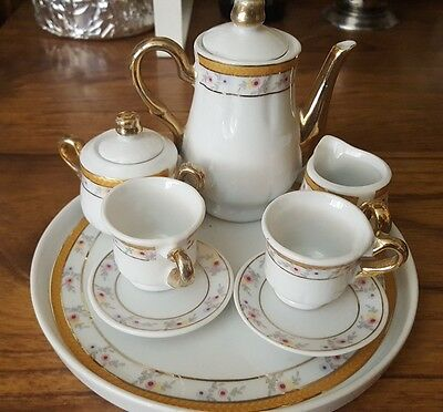 Gold trim and small floral print miniature tea set