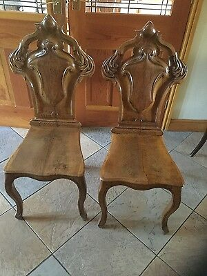 Pair of antique oak hall chairs