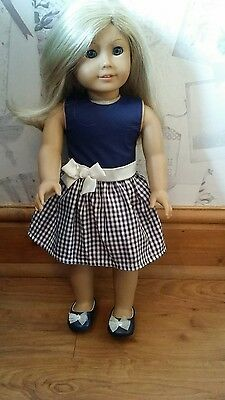 American Girl Doll with genuine dress
