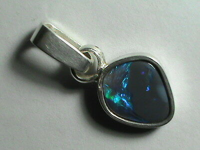 2.1ct Blue/green solid black/crystal opal set in handmade 925 st/silver pendant.