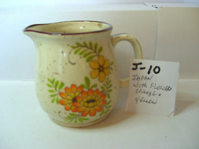 jug with orange and yellow flower japan