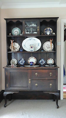 Period oak dresser, with small leaded glass cupboard in top.