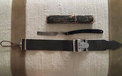 Our Daisy Antique Straight Razor and sharpening strap