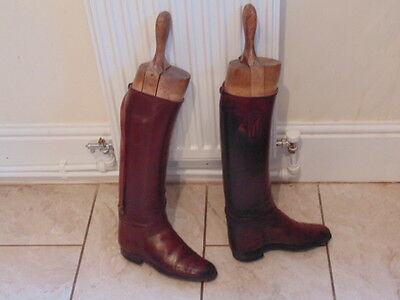 A pair of leather brown riding boots and wooden trees, size 5