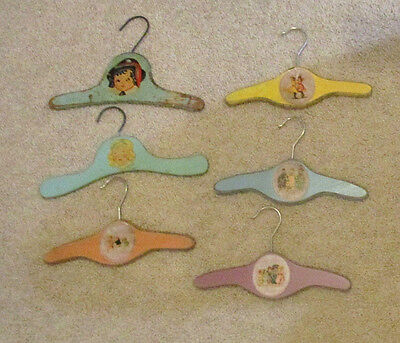 Vintage Wooden Children's Clothes Hangers With Children's Pictures On Each