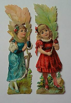 2 Embossed Diecut  Victorian  Scraps, Girls holding large leaves