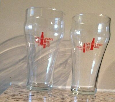 Two matching Coca-Cola 125th year anniversary glasses