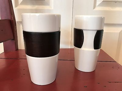 2 Starbucks 14 fl oz. Cups with bamboo sleeve.   New.