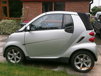 Metallic silver Smart Car ForTwo. Cabriolet Convertible. 2010.