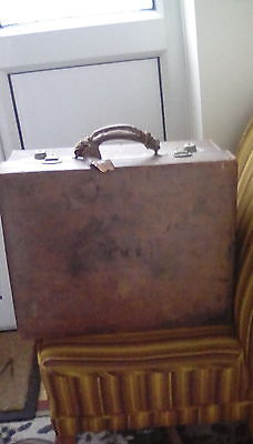 Vintage heavy brown leather suitcase