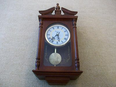 An Vintage Wood Cased Wall Chiming Clock  Pendulum  & New Batteries  Working