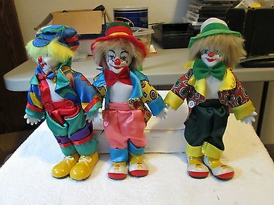"three(3) beautiful porclain clown dolls about 9-1/2"" high- very clean- perfect"