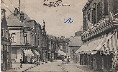 CPA : Caudry , Rue Gambetta , commerce confections