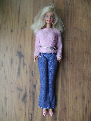 Vintage Barbie doll with clothes and shoes, 1966 body shape.