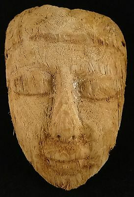 "Ancient Egyptian carved wood mummy mask, 600-30 BCE, 9 ¾"" x 6 ¾"" ."