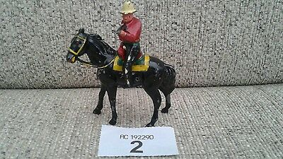 Vintage lead cowboy on black horse
