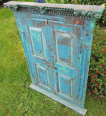 Distressed hand carved wooden window shutters