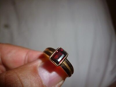 new ladies 9k yellow gold ring with a 7mmx4.5mm natural garnet