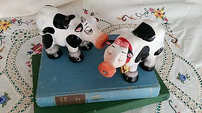 Kitsch and cute 'kissing cow' salt and pepper shakers