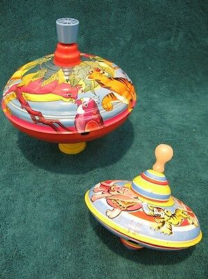 Two Vintage Tin Toy Spinning Tops