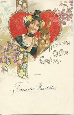 Art Nouveau. Lady with Rabbit & easter eggs in design