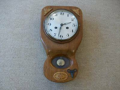An Early Wood Cased Wall Chiming Clock  With Key & Pendulum