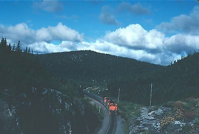 QCM Quebec Cartier Mining M-636 77 with ore train - two action views  Kodachrome