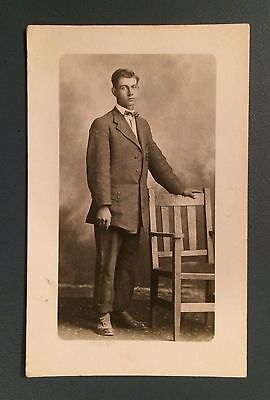 Vintage Real Photo Postcard RPPC Portrait of a Man Standing next to a Chair
