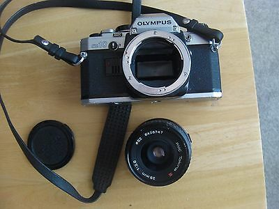 Olympus OM 10 Camera with RMC Tokina 28mm 1:2,8 lens, see photo