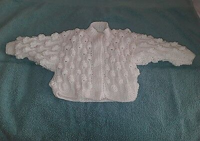 babys age 0/6 mths white hand knitted long sleeve cardigan