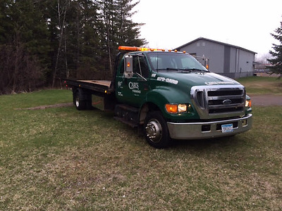 06 Ford F650 Extended Cab Rollback Wrecker with 21' steel Jerr-Dan Carrier